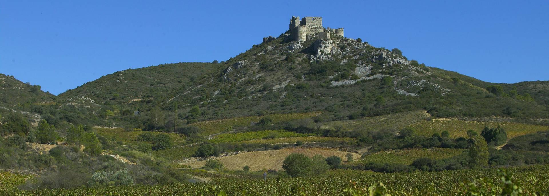 """<a href=""""http://www.payscathare.drupal.rc-preprod.com/les-sites/chateau-d-aguilar"""">Château d'Aguilar</a>"""
